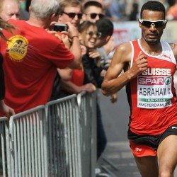 Half-marathon gold for Tadesse Abraham and Sara Moreira in Amsterdam