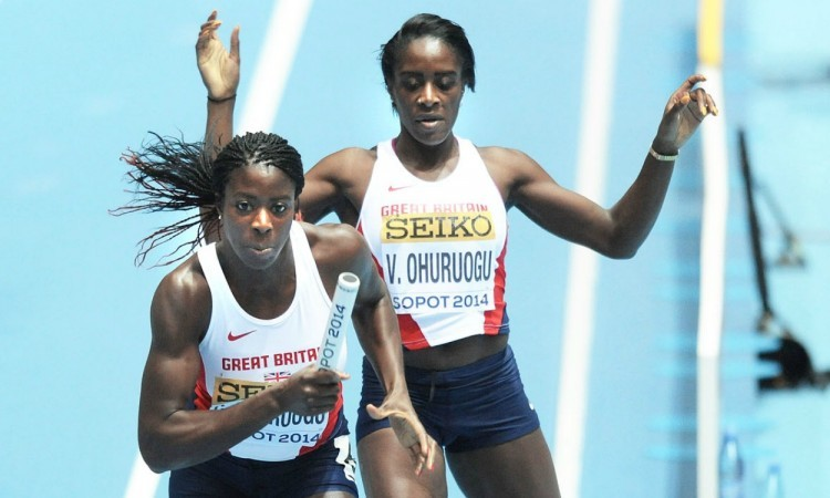 Victoria Ohuruogu hands baton to Christine Ohuruogu at Sopot 2014 (Credit: Mark Shearman)