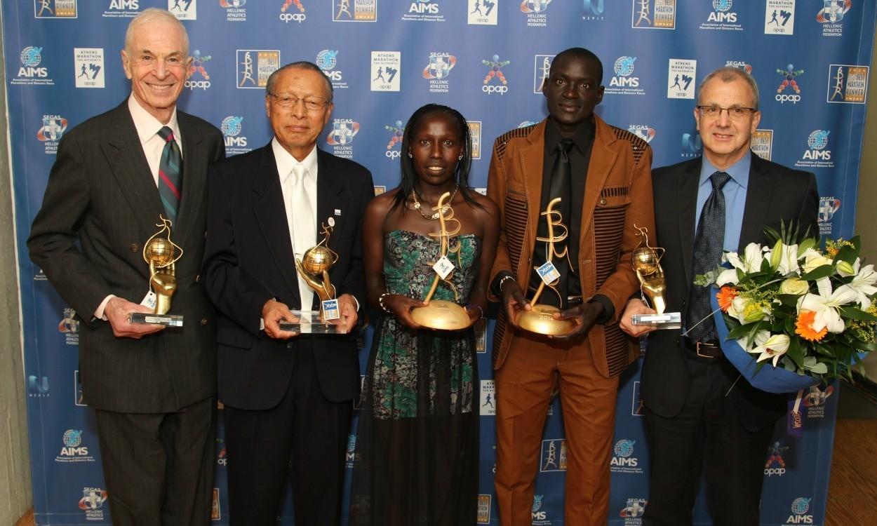 Dennis Kimetto and Florence Kiplagat receive AIMS awards