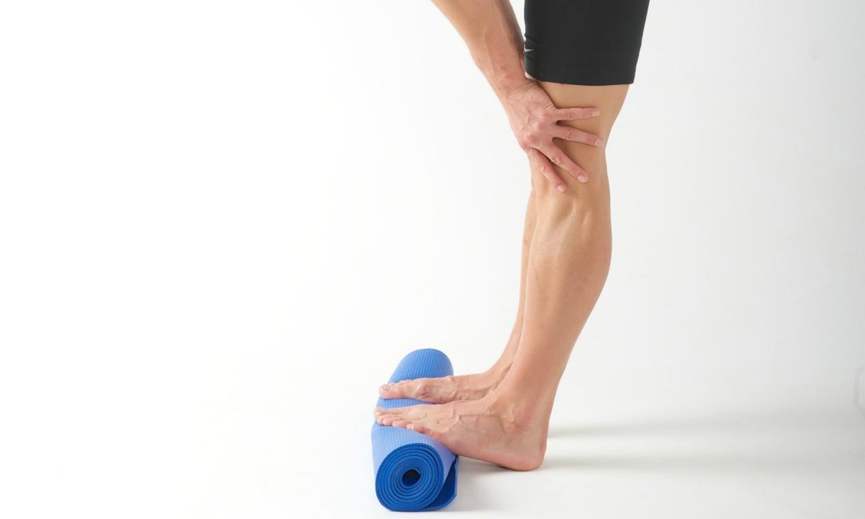 Calf stretch: Rolled mat