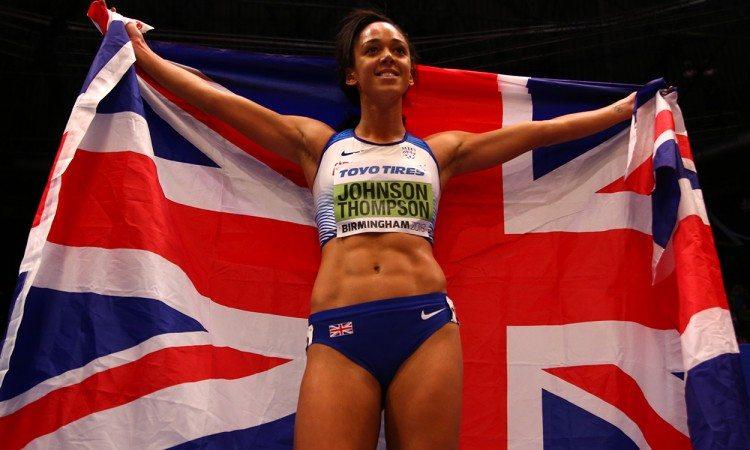 Johnson-Thompson-with-flag_IAAF_Worlds-Getty-for-IAAF