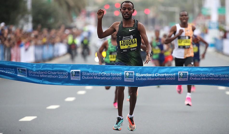 Olika Adugna wins historic men's marathon as Worknesh Degefa takes title No.2 in Dubai